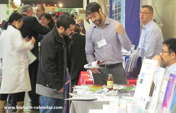 Bioscience Lab Scientist Looks Over Lab Supplies Offered by Rep at Mount Sinai, School of Medicine BioResearch Product Faire™ Event