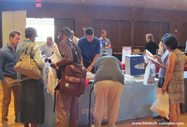 researchers view life science vendor products and talk on current events University of Wisconsin Research Park BioResearch Product Faire™ Event